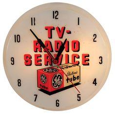 GE TV-Radio Service plastic light-up clock.