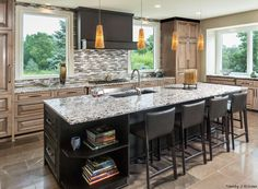 This kitchen has a large island and a beautiful glass tile backsplash. Also, the kitchen cabinets and countertops are stunning! On average, it costs $2,705 to install new kitchen countertops.