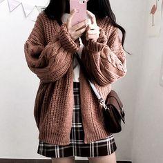 chunky cardigan and plaid skirt.
