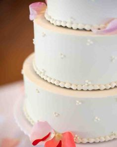 Seattle wedding: The outside of this cake was piped with a delicate pattern. Inside, was an ombre of pink and red cake with cream cheese frosting.