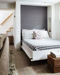 Love this rustic Murphy Bed with plan panelling and storage inside the alcove.