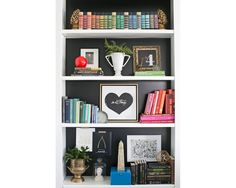 Inspiration: pretty bookshelf. Grouping books by color makes such a big difference.