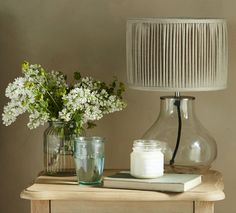 Bessy is an easy-going little glass table lamp with a pleated shade. Comes in natural linen or silk. Works in the living room or as pretty bedside lighting.