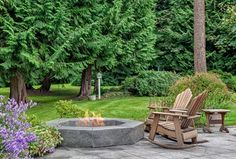 Traditional Patio with exterior stone floors, Fire pit