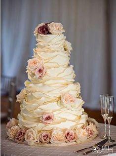 Ruffled wedding cake with roses by Fancy Cakes by Leslie 301-652-9390  www.fancycakesbyleslie.com  4939 Elm Street Bethesda, MD 20814