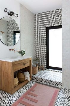 If you're into clean lines, modern design, and a splash of matte black, then a minimalist bathroom light fixture that's both stylish and subtle is probably the best thing for you. #hunkerhome #minimalistbathroom #minimalistbathroomideas #bathroomideas #minimalbathroomideas Bathroom Trends, Bathroom Inspo, Bathroom Inspiration, Bathroom Ideas, Bathroom Renovations, Bathroom Images, Furniture Inspiration, White Bathroom, Small Bathroom