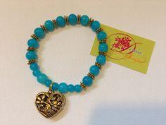 photo (67) pulsera de bolitas azul aqua y corazón dorado.