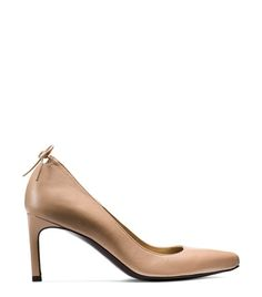 These pointed-toe pumps feature a slim mid-heel and subtle cutout detail on the heel counter, which is finished with the SW signature tie back detail. Amp up your 9-to-5 wardrobe and wear this razor-sharp silhouette with tailored wide-leg trousers and a sleeveless vest.
