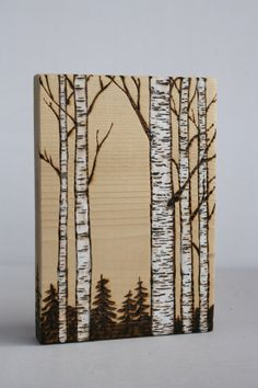 This lovely art block has a woodland birch forest scene burnt into the wood and details have been added with white paint. A small hole has been drilled into the back for easy wall hanging on a small nail. Signed and dated on the back. Measures 5 1/2 inches tall by 3 3/4 inches wide.  A perfect addition to woodland decor