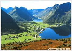 Syvde, Norway   little town of Syvde is surrounded by green hills, mountains and the Syvde Fjord