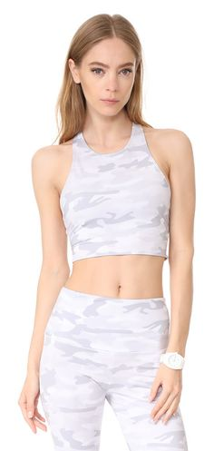 peek a boo camo crop tank by onzie. This cropped Onzie racerback tank top has an understated camouflage print. Elastic band. Lined. Fabric: Activewear je...
