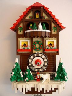 LEGO Cuckoo Clock~~How cool is this? I wonder if the top part would really turn like a cuckoo clock would Lego Christmas Village, Lego Winter Village, Christmas Themes, Holiday Decor, Christmas Clock, Christmas Crafts, Lego Design, Lego Sets, Lego Boards
