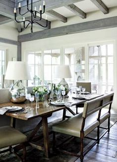 If no dedicated dining room space, why not back the sofa with a table used for dining?  A bench and two armchairs at each end give this balance in the room.