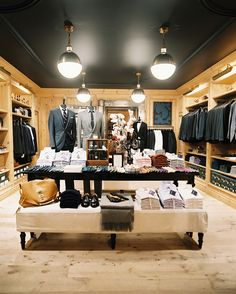 Rustic Traditional Retail Store Design: Clothing on display at the J.Crew Men's Shop.