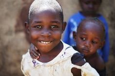 Happy girls outside the coffee-factory in Kimilili, Kenya (by Diana Savina)