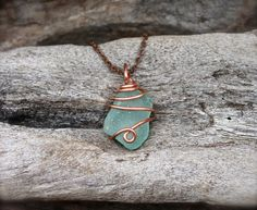 This rare aqua blue piece of sea glass chunk was found along a beach on the north shore of Oahu, Hawaii. The aqua blue seaglass has been wire