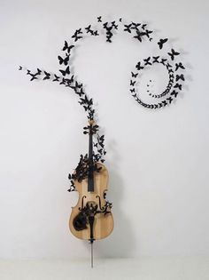 Is it a cello? My first love was the violin. But my true passion was the cello. Art Papillon, Butterfly Decorations, Wall Decorations, Wow Art, Butterfly Art, Pics Art, Oeuvre D'art, Sculpture Art, Amazing Art