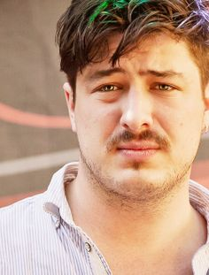 even pouting he look gorgeous!! Marcus Mumford