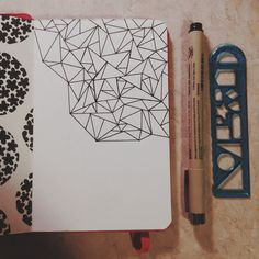 Progress shot, triangles drawn in microns in my little red moleskine. :)