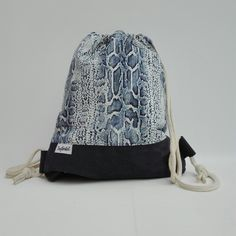 Handmade Backpack with animalprint and blue leather. For sale at DaWanda