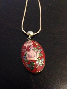 Red pendent necklace with pink rose on Etsy, $20.00