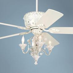 An awesome Compromise for my daughters bedrrom..chandelier and a fan for the warm Florida weather :)