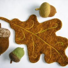 Capture the spirit of autumn with a larger-than-life felted acorn and oak leaf. The acorn comes in 3 sizes: small, medium and large. The oak leaf measures, after felting, about 19 inches long. It makes a whimsical centerpiece or trivet for your holiday table!A large oak leaf using two strands of worsted weight yarn together. The pattern includes three sizes of acorns.Great for a Autumn trivet.