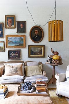 The most beautiful gallery walls from the pages of Vogue Living: A selection of vintage portraits, landscapes and still lifes in Lyn Gardner's Melbourne home.