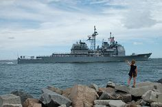 A little girl waves as the guided-missile cruiser USS Hue City (CG 66) departs Naval Station Mayport to join the USS Eisenhower Carrier Strike Group (CSG) for deployment. (U.S. Navy photo by Michael Leger/Released)