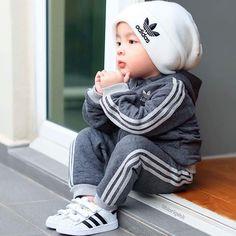 Little boy dressed in adidas