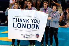 United States swimming gold medallists (L-R) Michael Phelps, Nathan Adrian, Matthew Grevers and Brendan Hansen send a message of thanks after the medal ceremony for the Men's 4x100m Medley Relay Final at the Aquatics Centre on August 4, 2012