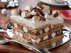 Ingredients        1 (14.4-ounce) box honey graham crackers      2 (4-serving) packages chocolate instant pudding mix      3 cups milk      2 1/4 cups mini-marshmallows, divided      1 (8-ounce) container frozen whipped topping, thawed      chocolate shavings for garnish