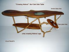 crossing walnut, side/coffee table white oak slabs with walnut legs all cris-crossing one another, I inserted a smoked glass inlay