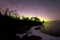 A Stunning Aurora Over Lake Michigan The ethereal Aurora Borealis lights Lake Michigan's night sky.