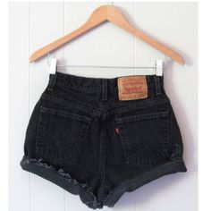 """Vintage Levi's High Waisted Cut Off Denim Shorts Size: 24 *SIZE NOTE* Bought from an ebay seller who measures in the following manner: """"24"""" is the actual waist measurement doubled and not the tag size (12"""" across the very top of the waist). To know if these will fit, please measure a pair you own the way we do in the photos then compare your measurements to ours."""" Color: Black Worn: Never but vintage/reconstructed Description: • Reconstructed vintage levi's • High-waisted style • Worn cuffed…"""