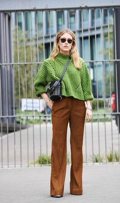 af29fd048b Give corduroy pants an elevated feel by wearing with a chunky-knit cropped  sweater and