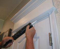 I posted about some overhead door moulding cornices that we saw on the Parade of Homes and that we already did a large moulding Cornice on the inside, over the front door. I've had a lot of h… Door Molding, Moldings And Trim, Cornice Moulding, Crown Moldings, Trim Work, Door Trims, Parade Of Homes, Do It Yourself Home, Interior Exterior