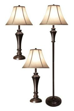 Styled with a bronzed steel base and soft ivory shade, the pair of table lamps and floor lamp seamlessly unifies your lighting in formal to casual settings.