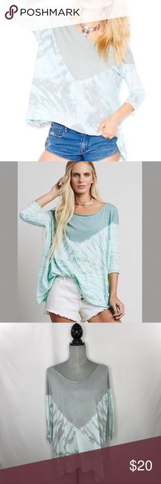 We The Free La Livin Coastal tee Cute and comfy oversized tee. Wide neck, three quarter sleeves, uneven hem, raw trim. Small imperfection in front by chest area, please see picture. Price reflects imprecation. Free People Tops