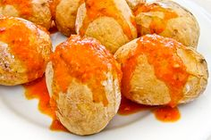 Papas Arrugadas, Canarian wrikley potatoes, covered in a spicy mojo sauce #SpanishCuisine #Food #Travel #SpanishFood