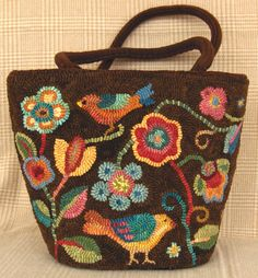 "hooked tote bag...by Holly Hill Designs. Make Crochet appliques, attach w/ ""Aleen's OK to Wash It"" glue."