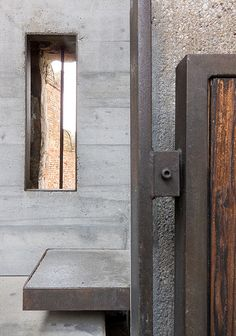 Castelvecchio - Carlo Scarpa - Step detail. Steel form filled with concrete. Steel and timber balustrade.