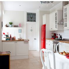 White country kitchen with red accessories | Modern kitchen ideas | Ideal Home | Housetohome.co.uk