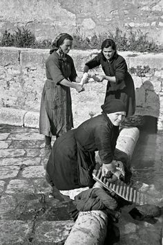 Local women washing clothes in the old Roman  washing place in Campobasso, Italy, 3 May 1944