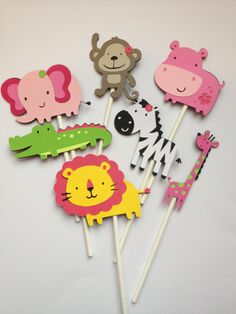 12 Pink/Lime Safari/ Jungle Animal Cupcake Toppers Great for Baby Showers,Birthday Parties,zoo animals,elephant,monkey,zebra, lion, hippo. $10.00, via Etsy.