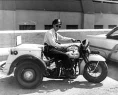 Cop on his Servi-Car, sixties