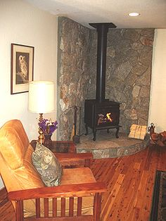 Corner woodstove, black, on raised stone hearth with floor-to-ceiling stone surrounding it. My hearth is bigger and dated. Need ideas for makeover. Inglenook Fireplace, Small Fireplace, Fireplace Hearth, Stove Fireplace, Fireplaces, Wood Stove Surround, Wood Stove Hearth, Wood Burner, Wood Stove Decor
