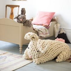 Imagine riding a gigantic bunny across the country side? Your kiddo will be over the moon with this fabulous oversized bunny. Let her imagination run wild while she snuggles and plays with her new favorite pal.This pattern is an arm knitting pattern and includes directions for both the giant bunny and the smaller one. If you don't know how to arm knit please also buy my How To Arm Knit PDFor take my free class at Creativebug: https://www.youtube.com/watch?v=aWlUkpPgebo