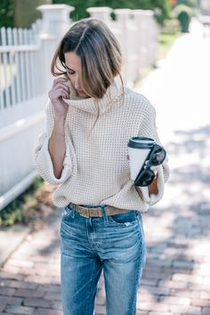 Fall style in a chunky knit sweater, rag and bone leather belt and boyfriend jeans on Jess Kirby