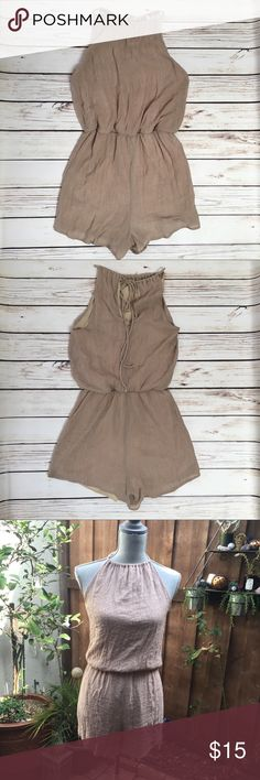 """Neutral Halter Romper Neutral Halter Romper. Light weight fiber and feel. Dress up or dress down. This piece can be styled multiple ways. Worn twice on vacation. As is. In great condition. 30"""" long. 2"""" inseam. NOT FP. Listed for exposure. Free People Pants Jumpsuits & Rompers"""